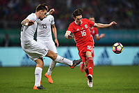 """Harry Wilson, right, of Wales national football team kicks the ball to make a pass against players of Uruguay national football team in their final match during the 2018 Gree China Cup International Football Championship in Nanning city, south China's Guangxi Zhuang Autonomous Region, 26 March 2018.<br /> <br /> Edinson Cavani's goal in the second half helped Uruguay beat Wales to claim the title of the second edition of China Cup International Football Championship here on Monday (26 March 2018). """"It was a tough match. I'm very satisfied with the result and I think that we can even get better if we didn't suffer from jet lag or injuries. I think the result was very satisfactory,"""" said Uruguay coach Oscar Tabarez. Wales were buoyed by a 6-0 victory over China while Uruguay were fresh from a 2-0 win over the Czech Republic. Uruguay almost took a dream start just 3 minutes into the game as Luis Suarez's shot on Nahitan Nandez cross smacked the upright. Uruguay were dealt a blow on 8 minutes when Jose Gimenez was injured in a challenge and was replaced by Sebastian Coates. Inter Milan's midfielder Matias Vecino of Uruguay also fired at the edge of box from a looped pass but only saw his attempt whistle past the post. Suarez squandered a golden opportunity on 32 minutes when Ashley Williams's wayward backpass sent him clear, but the Barca hitman rattled the woodwork again with goalkeeper Wayne Hennessey well beaten."""