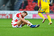 Herbie Kane of Doncaster Rovers (15) checks his shin after taking a knock during the EFL Sky Bet League 1 match between Doncaster Rovers and AFC Wimbledon at the Keepmoat Stadium, Doncaster, England on 17 November 2018.