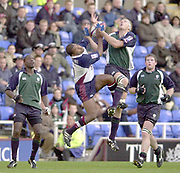 Reading, Berkshire, UK., 26th October 2003, Zurich Premiership Rugby, Madejski Stadium, England, [Mandatory Credit: Peter Spurrier/Intersport Images],<br />  <br /> <br /> 2003_04 Zurich Premiership Rugby - London Irish v Rotherham<br /> High Ball - Rotherhams, Jacob Rauluni [left] and Exiles shipper Ryan Strudwick jump for the ball. as Exiles Paul Sackey far left and Phil Murphy far right watch.