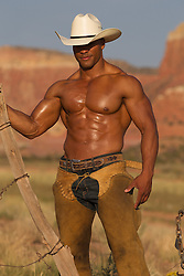 shirtless muscular cowboy in chaps showing off his abs and toned body