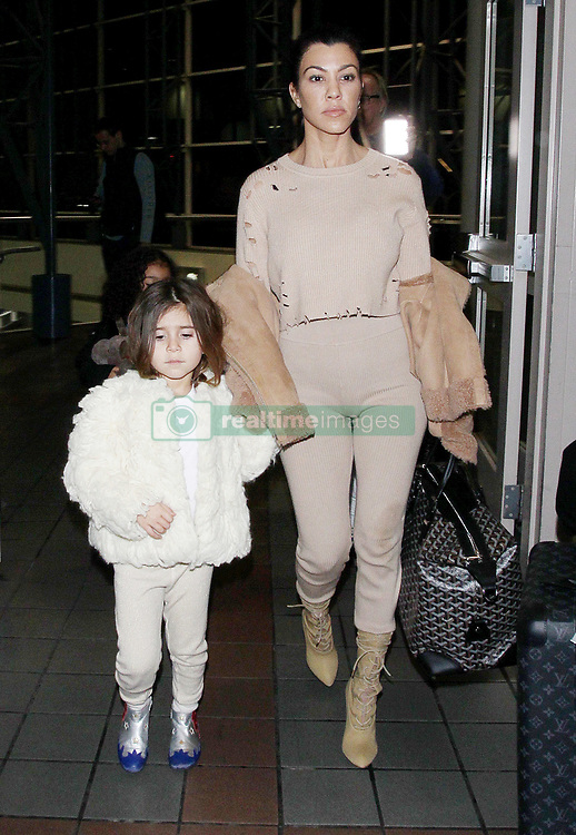 Kourtney Kardashian, daughter Panelope and niece North West arriving at the Los Angeles International Airport. 04 Feb 2018 Pictured: Kourtney Kardashian, Penelope, North West. Photo credit: MEGA TheMegaAgency.com +1 888 505 6342