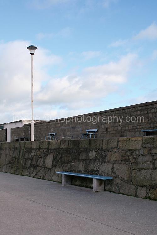 Benches along DunLaoghaire Pier Dublin Ireland in the winter