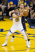 Golden State Warriors forward Omri Casspi (18) battles for the ball in the post against the Utah Jazz at Oracle Arena in Oakland, Calif., on December 27, 2017. (Stan Olszewski/Special to S.F. Examiner)