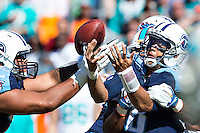 NASHVILLE, TN - OCTOBER 18:  Marcus Mariota #8 of the Tennessee Titans has the ball knocked loose while trying to throw a pass against the Miami Dolphins at LP Field on October 18, 2015 in Nashville, Tennessee.  The Dolphins defeated the Titans 38-10.  (Photo by Wesley Hitt/Getty Images) *** Local Caption *** Marcus Mariota