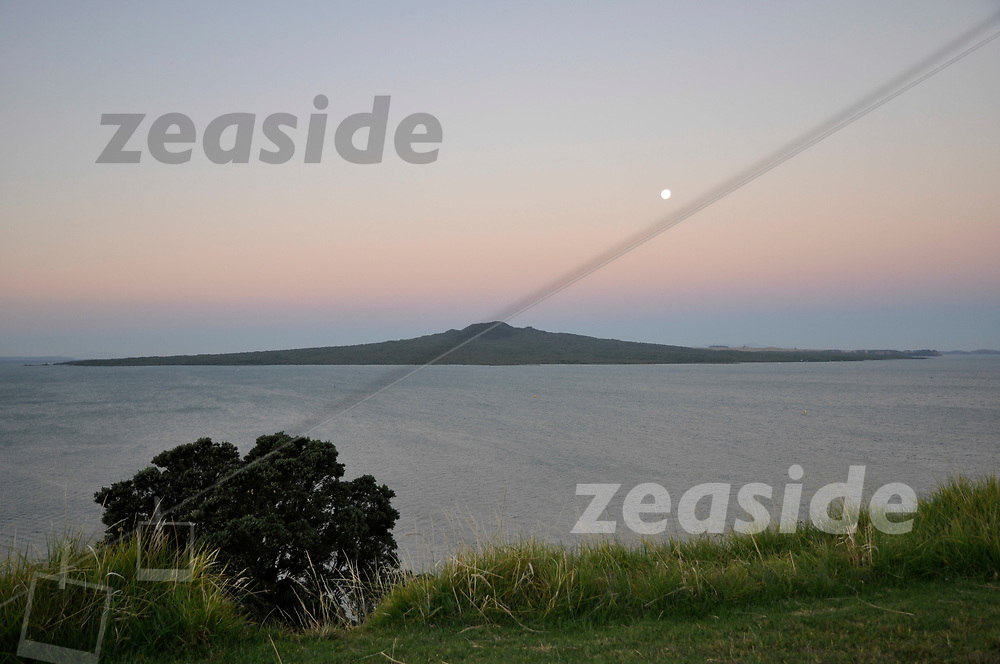 Rangitoto, a volcanic island off the coast of Auckland, with full moon, as seen from North Head, another extinct volcano at the southern tip of the North Shore of Auckland.