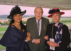 Left to right, MRS GAVIN BURKE with her parents DUKE & DUCHESS OF RICHMOND AND GORDON owners of Goodwood, at a race meeting in Sussex on 31st July 1998.MJH 17