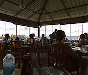 People inside terrace restaurant town of Galle, Sri Lanka, Asia