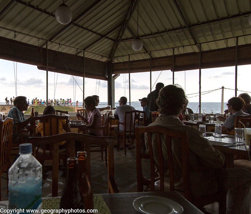 People inside terrace restaurant town of Galle, Sri Lanka, Asia