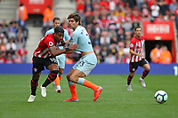 Football - 2018 / 2019 Premier League - Southampton vs. Chelsea<br /> <br /> Southampton's Mario Lemina is held back by Marcos Alonso of Chelsea during the Premier League match at St Mary's Stadium Southampton  <br /> <br /> COLORSPORT/SHAUN BOGGUST