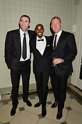 Left to right, MARTIN KEOWN, MO FARAH and RAY PARLOUR at 'A Night of Champions' an evening to raise funds for the Mo Farah Foundation held at The Hurlingham Club, London on 28th August 2014.