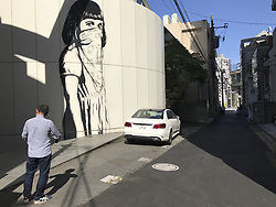 May 23, 2017 - Tokyo, Japan - A mural of a girl with the face cover can be seen in the streets of Tokyo Japan on May 23, 2017. Photo by: Ramiro Agustin Vargas Tabares (Credit Image: © Ramiro Agustin Vargas Tabares via ZUMA Wire)