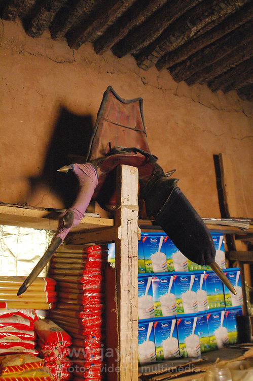Niger,Agadez,2007. A Tuareg camel saddle sits proudly atop the shelves in Takita Ixa's small shop at the family home.