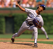 CHICAGO - CIRCA 1995:  Ramon Martinez of the Los Angeles Dodgers pitches during an MLB game versus the Chicago Cubs at Wrigley Field in Chicago, Illinois during the 1995 season. (Photo by Ron Vesely) Subject:   Ramon Martinez
