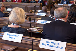 © Licensed to London News Pictures. 22/10/2018. Bristol, UK. Global Parliament of Mayors Annual Summit, 21-23 October 2018, at Bristol City Hall. Picture of the plenary session on harnessing the power of migration. The Global Parliament of Mayors 2018 is the biggest and most ambitious Annual Summit to date. GPM Bristol 2018 will host up to 100 global mayors for an action-focused summit that addresses some of the biggest challenges facing today's world cities. GPM Bristol 2018's theme, Empowering Cities as Drivers of Change, will focus minds on global governance and the urgent need for the influence, expertise and leadership of cities to be felt as international policy is shaped. GPM Bristol 2018 will provide mayoral delegates with a global network of connections and a space to develop the collective city voice necessary to drive positive change. The programme will engage participants in decision-making, with panels, debate and voting on priority issues including migration and inclusion, urban security and health, and is a unique chance to influence decisions on the most pressing issues of our time. Photo credit: Simon Chapman/LNP