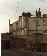 Old amateur photos of Dublin streets churches, cars, lanes, roads, shops schools, hospitals, Streetscape views are hard to come by while the quality is not always the best in this collection they do capture Dublin streets not often available and have seen a lot of change since photos were taken April 1984, clondalkin tower, sheds, chapwlizode fruit shop, general post office Kilmainham Hill Guinness Buildings, cottages beside river,