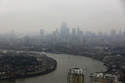 © Licensed to London News Pictures. 19/09/2021. London, UK. View of London Docklands and River Thames under thick mist. Photo credit: Dinendra Haria/LNP