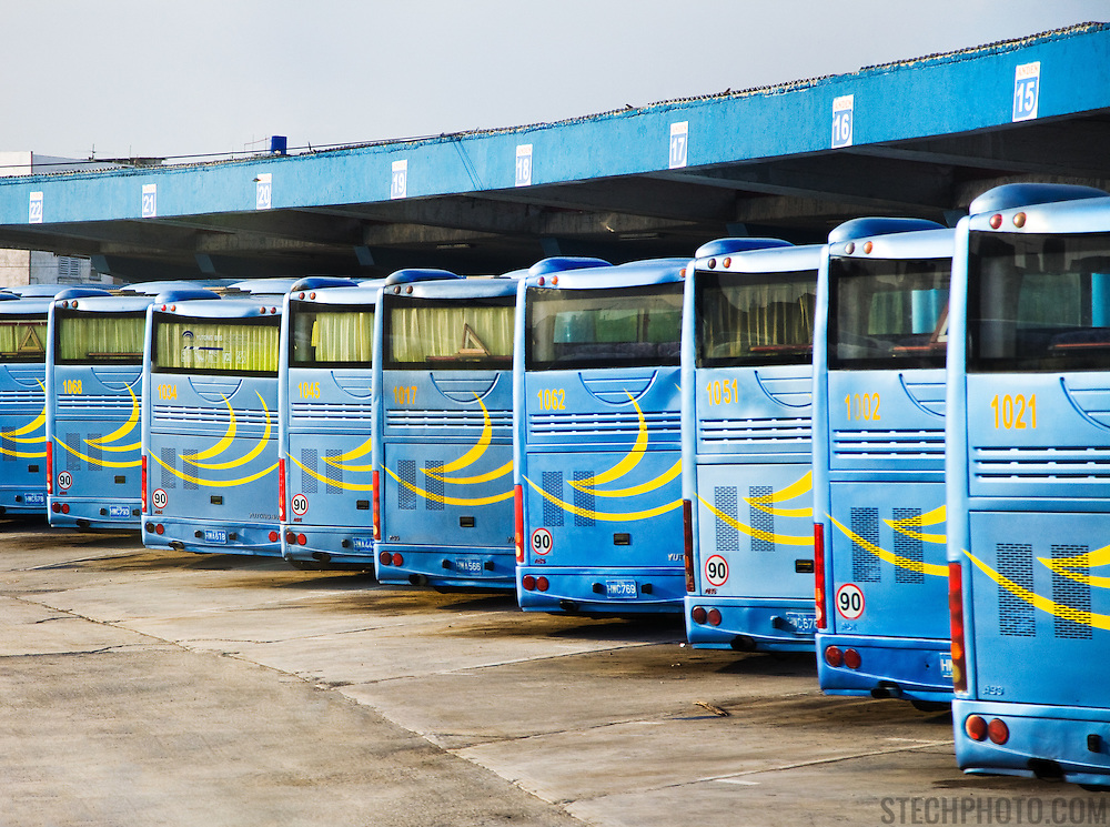 A row of buses at a bus station in Havana, Cuba.