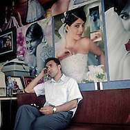 Man seating at the Wedding Photo Saloon in Igdir.