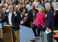 Democratic presidential nominee Hillary Clinton (C) with her husband Bill (R) laughs at a comment by her running mate Time Kaine (L) at a campaign kickoff rally after the Democratic National Convention in Philadelphia July 29, 2016.  REUTERS/Rick Wilking