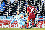 Goalkeeper Jordan Archer of Millwall makes himself big to save a close range shot from Shinji Okazaki of Leicester City .The Emirates FA Cup 5th round match, Millwall v Leicester City at The Den in London on Saturday 18th February 2017.<br /> pic by John Patrick Fletcher, Andrew Orchard sports photography.