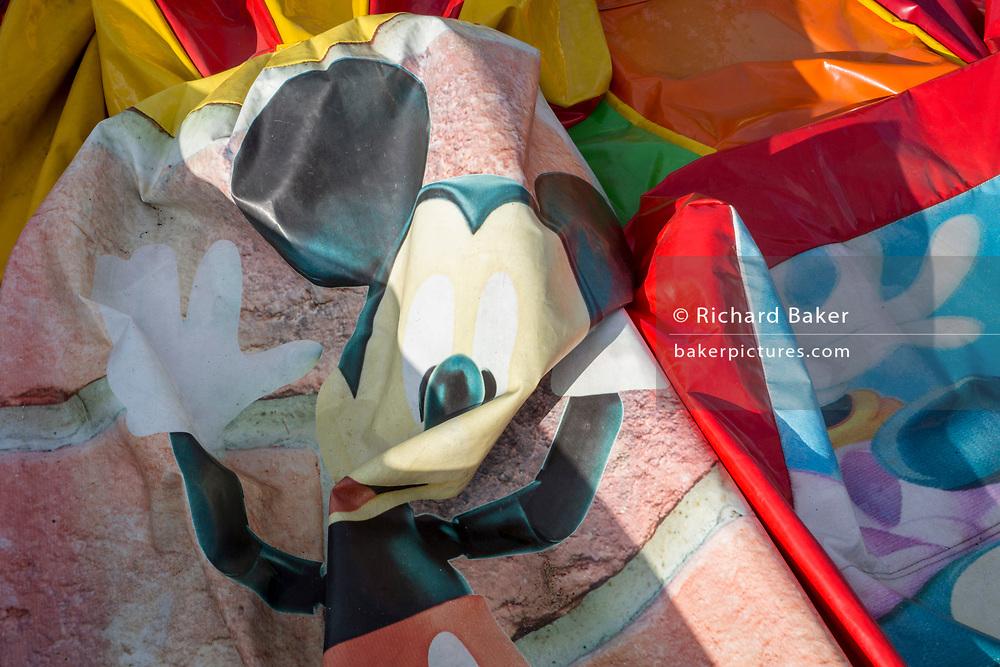 A landscape of a Polish version of Disneyland that features a deflated childrens' inflatable bouncy castle, on 18th September 2019, near the Wielka Krokiew ski jump, Zakopane, Malopolska, Poland.