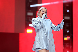 Anne-Marie on stage during Capital's Summertime Ball. The world's biggest stars perform live for 80,000 Capital listeners at Wembley Stadium at the UK's biggest summer party.