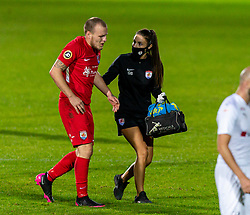 WREXHAM, WALES - Thursday, September 17, 2020: Connah's Quay Nomads' Jamie Insall limps off with physio Gemma Bamford during the UEFA Europa League Second Qualifying Round match between Connah's Quay Nomads FC and FC Dinamo Tbilisi at the Racecourse Ground. Dinamo Tiblisi won 1-0. (Pic by David Rawcliffe/Propaganda)