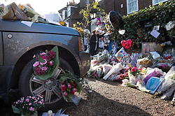 Tributes left on a Range Rover outside the home of George Michael in Highgate, north London, as his boyfriend denied sending tweets speculating about the cause of the pop superstar's death and said his Twitter account was hacked.