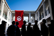 Tunisian voters wait in line during the first  free elections in decades in Tunis October 23, 2011. The election, the first free vote in Tunisia's history, is a standard for other Arab countries who have had revolutions.
