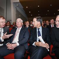 Nederland, Amsterdam , 15 mei 2014. <br /> Minister-president Rutte opende donderdag 15 mei de Nederlandse vestiging van de Europese Investeringsbank (EIB) in Amsterdam. <br /> Pim van Ballekom, vice-president (links naast de premier)  en rechts Werner Hoyer, de president van de EIB. Helemaal links Bernard Wientjes voorzitter van de werkgevers (VNO-NCW )..De EIB is het financieringsinstituut van de Europese Unie.<br /> De 28 lidstaten zijn aandeelhouder. De bank is opgericht in 1958 bij het Verdrag van Rome en heeft als doel projecten te financieren die zijn gericht op de versterking van de Europese economie.<br /> Prime Minister Rutte  opened Thursday, May 15th, the Dutch branch of the European Investment Bank (EIB) in Amsterdam. Left of the premier Pim van Ballekom, Vice-President of the EIB and right Werner Hoyer, president.<br /> Left Bernard Wientjes, the president of the Dutch employers' organization Confederation of Netherlands Industry and Employers (VNO-NCW ).<br /> <br /> The EIB is the financing institution of the European Union.