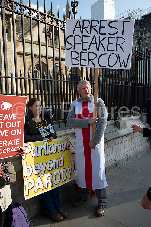 On the day the Prime Minister brings his Brexit bill for a vote at the House of Commons, Pro Brexit anti European Union Leave protesters demonstrating with a placard against the Speaker of the House John Bercow in Westminster on 22nd October 2019 in London, England, United Kingdom. Brexit is the scheduled withdrawal of the United Kingdom from the European Union. Following a June 2016 referendum, in which 51.9% of participating voters voted to leave.