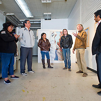 032113       Brian Leddy<br /> Fitz Sargent, gesturing on right, speaks with Navajo Nation Museum employees Manuelito Wheeler, Clarenda Begay, Char Krueger,  local resident Kjell Boersma and district three city councilor Yogash Kumar at Art123 Thursday. The museum took a tour of downtown Gallup to see how they can become in the local arts scene.