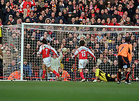 Robert Pires (Arsenal) scores Arsenal's goal past goalkeeper Paddy Kelly. Arsenal v Sheffield United. FA Cup 5th rd. 19/2/2005. Credit : Colorsport/Andrew Cowie.