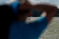 Augustow, woj. podlaskie, 22.07.2020. Ograniczenia w wyjazdach zagranicznych spowodowane pandemia koronawirusa zachecily ludzi do korzystania z urokow krajowych wyjazdow wakacyjnych. Augustow, polozony nad jeziorami Neckiem i Bialym, pomimo chlodnej drugiej polowy lipca, byl oblegany przez turystow z calej Polski N/z czlowiek na desce surfingowej fot Michal Kosc / AGENCJA WSCHOD