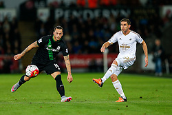Angel Rangel of Swansea City crossses past Marko Arnautovic of Stoke City - Mandatory byline: Rogan Thomson/JMP - 07966 386802 - 19/10/2015 - FOOTBALL - Liberty Stadium - Swansea, Wales - Swansea City v Stoke City - Barclays Premier League.