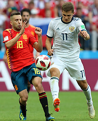 MOSCOW, July 1, 2018  Jordi Alba (L) of Spain vies with Roman Zobnin of Russia during the 2018 FIFA World Cup round of 16 match between Spain and Russia in Moscow, Russia, July 1, 2018. (Credit Image: © Yang Lei/Xinhua via ZUMA Wire)