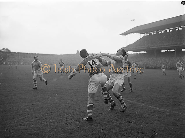Dublin and Derry players waiting for the ball to fall from the sky during the All Ireland Senior Gaelic Football final Dublin vs Derry in Croke Park on 28th September 1958. Dublin 2-12 Derry 1-9.