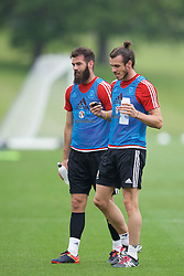 CARDIFF, WALES - Saturday, June 4, 2016: Wales' Joe Ledley and Gareth Bale during a training session at the Vale Resort Hotel ahead of the International Friendly match against Sweden. (Pic by David Rawcliffe/Propaganda)