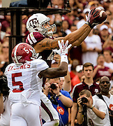 Sep 14, 2013; College Station, TX, USA; Texas A&M Aggies wide receiver Mike Evans (13) catches a pass over Alabama Crimson Tide defensive back Cyrus Jones (5)during the first half at Kyle Field. Mandatory Credit: Thomas Campbell-USA TODAY Sports