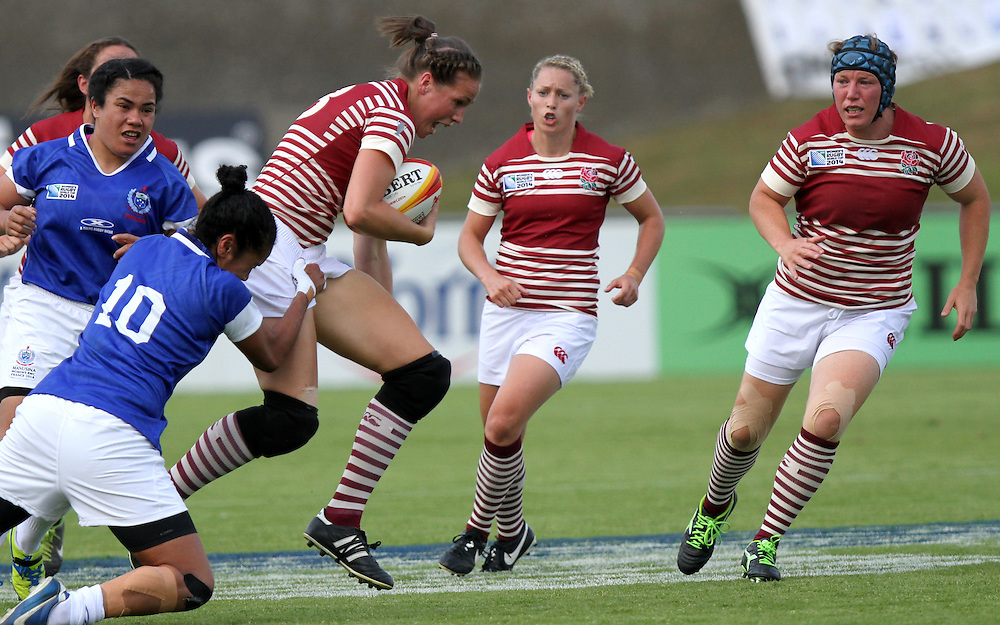 Emily Scarratt in action. England v Samoa Pool A group game, WRWC 2014 at Centre National de Rugby, Marcoussis, France, on 1st August 2014