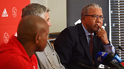 Cape Town-180727 Advocate Norman Arendse who was leading the Ajax Cape Town legal team in the Tendai Ndoro case against the Premier Soccer league,addressing the media about the decision to withdraw their appeal against judge Mukhari's judgement.Ajax will be competing in the NFD next season,a decision that was taken by the team today.In the middle is Ari Efstathiou the team's CEO and Supporters Liaison Officer Thabiso Shooz Mekuto.photograph:Phando Jikelo/African News Agency/ANA
