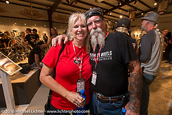 Cheryl and Mailman Kevin O'Brien on the Industry party night for Michael Lichter's tattoo themed Skin & Bones Motorcycles as Art exhibition at the Buffalo Chip during the annual Sturgis Black Hills Motorcycle Rally.  SD, USA.  August 7, 2016.  Photography ©2016 Michael Lichter.