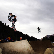 Competitors in action during the 'Red Bull Roast It' BMX competition with riders from around the globe competing at the Gorge Road Jump Park, Queenstown, South Island, New Zealand. 18th February 2012. Photo Tim Clayton