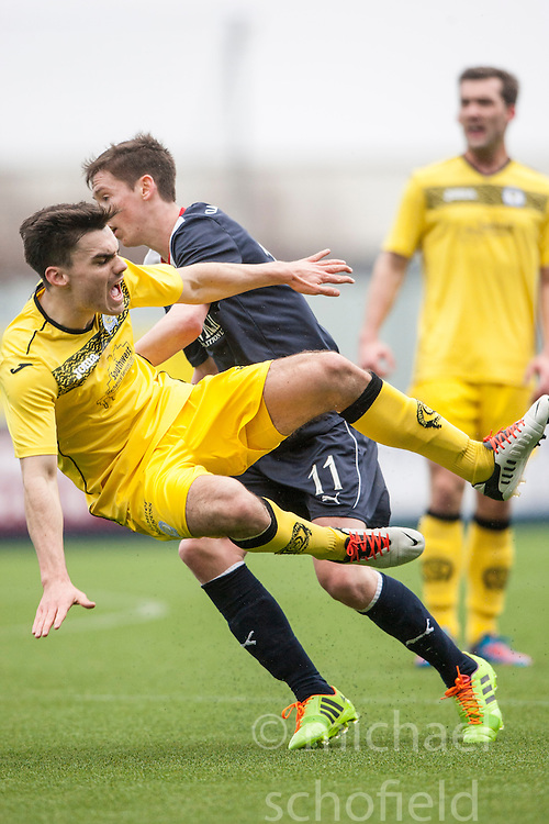 Queen of the South's Ian McShane tackled by Falkirk's Conor McGrandles.<br /> Half time : Falkirk 0 v 0 Queen of the South, Scottish Championship game today at the Falkirk Stadium.<br /> © Michael Schofield.