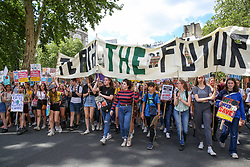 May 24, 2019 - London, UK, United Kingdom - Students seen holding a banner and placards during the protest..Youth Strike for Climate Change Protest, calling on politicians and business leaders to protect the environment from greenhouse gas emissions and to address the impact it has on the environment. (Credit Image: © Dinendra Haria/SOPA Images via ZUMA Wire)