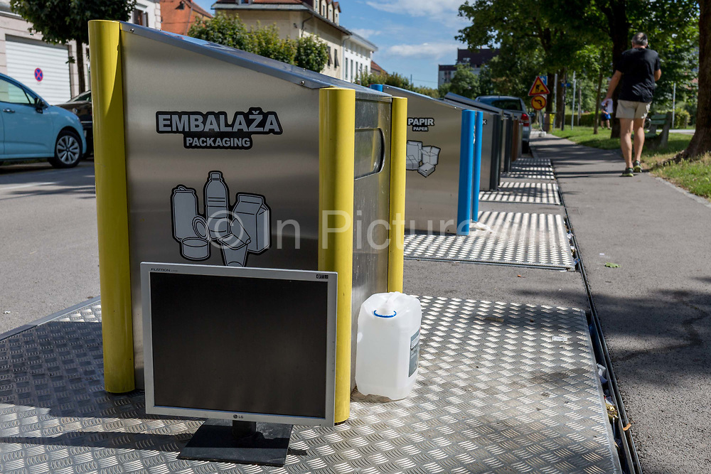 Recycling bins on a street in the Slovenian capital, Ljubljana, on 27th June 2018, in Ljubljana, Slovenia. Recycling contractor Snaga collects and separates waste Snaga collects waste in the area of the City of Ljubljana and nine municipalities in the vicinity. Bins are loacted around the capital for the following materials: Waste paper and carton, glass and packaging collection unit, and recently introduced packaging and paper bins at collection sites; biological waste in brown bins at collection sites, bulky waste free removal upon order, paid removal upon order collection centre; hazardous waste movable collection unit, collection unit at the Povsetova collection centre; waste electrical and electronic equipment collection centre, movable collection unit – for small items only and other waste black or grey bins at collection sites.
