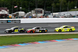 July 22, 2018 - Loudon, NH, U.S. - LOUDON, NH - JULY 22: Jimmie Johnson, Monster Energy NASCAR Cup Series driver of the Lowe's For Pros Chevrolet (48),, Martin Truex Jr, Monster Energy NASCAR Cup Series driver of the 5-hour Energy / Bass Pro Shops Filters Toyota (78),  and Ryan Blaney, Monster Energy NASCAR Cup Series driver of the Menards / Sylvania Ford (12), during the Foxwoods Resort Casino 301 on July 22, 2018, at New Hampshire Motor Speedway in Loudon, New Hampshire. (Photo by Fred Kfoury III/Icon Sportswire) (Credit Image: © Fred Kfoury Iii/Icon SMI via ZUMA Press)