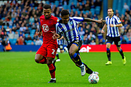 Kadeem Harris of Sheffield Wednesday battles with Liam Palmer of Sheffield Wednesday during the EFL Sky Bet Championship match between Sheffield Wednesday and Wigan Athletic at Hillsborough, Sheffield, England on 5 October 2019.