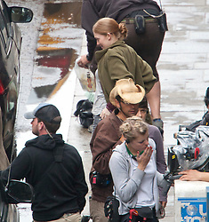 """Day two of filming.  Brad Pitt's co-stars Mireille Enos on the set of the movie """"World War Z"""" being shot in the city centre of Glasgow. The film, which is set in Philadelphia, is being shot in various parts of Glasgow, transforming it to shoot the post apocalyptic zombie film.."""
