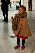 A young girl on her way into the Fashion Week show, wearing a red dress, red shows, and a red hairband. She was the youngest attendee I saw there today.